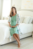 Hadley printed robe with Sage labor gown. Hadley is a cream and blue flowered print against a white background. Sage labor gown coordinates nicely with the green stems of Hadley flowers. Spoil mom with this robe and labor gown set.