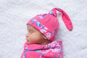Rose swaddle and knotted hat.