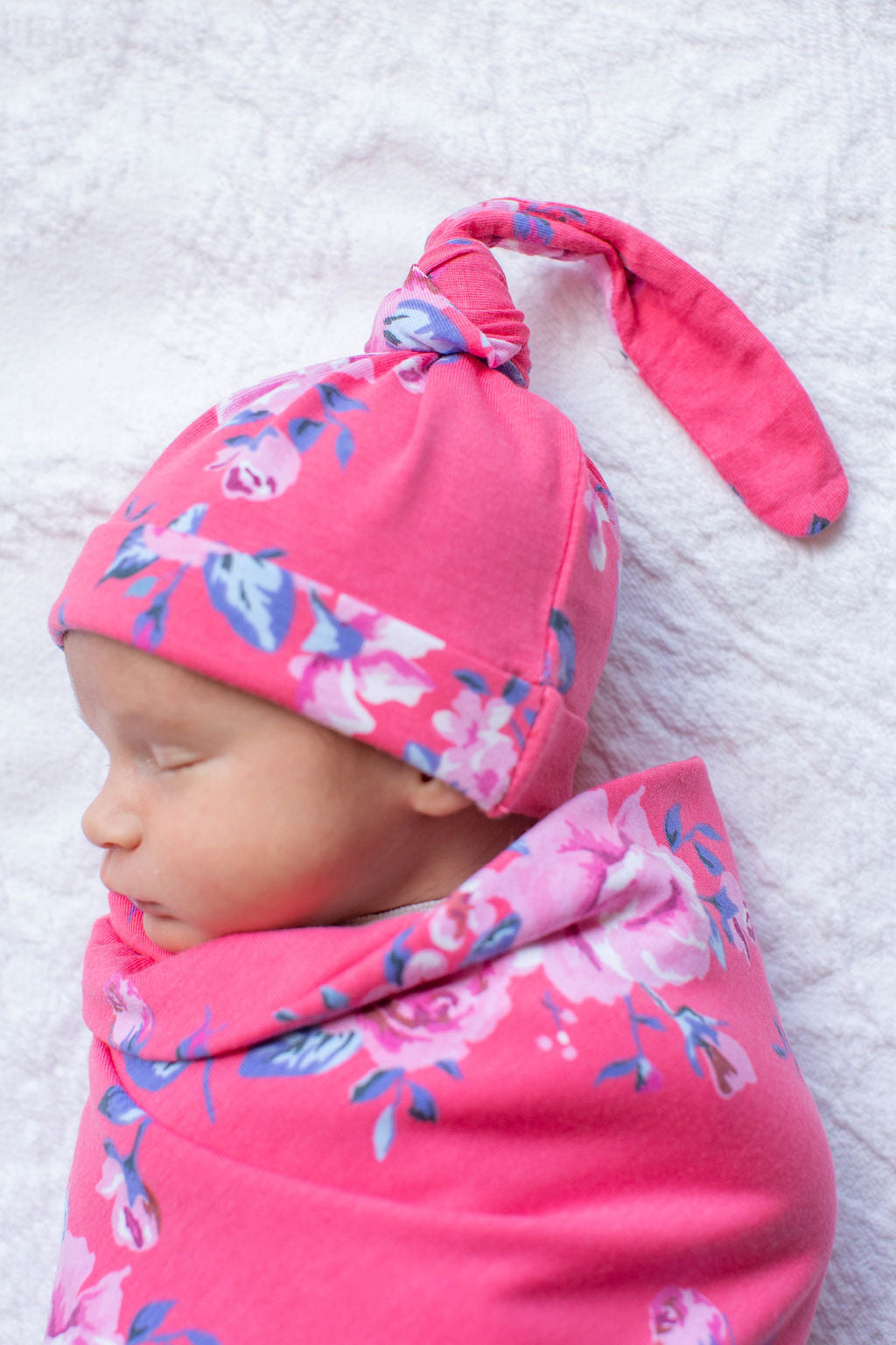 Fuschia pink background with light pink flowers, Rose print. Double-lined swaddle and hat set for ultimate coziness.