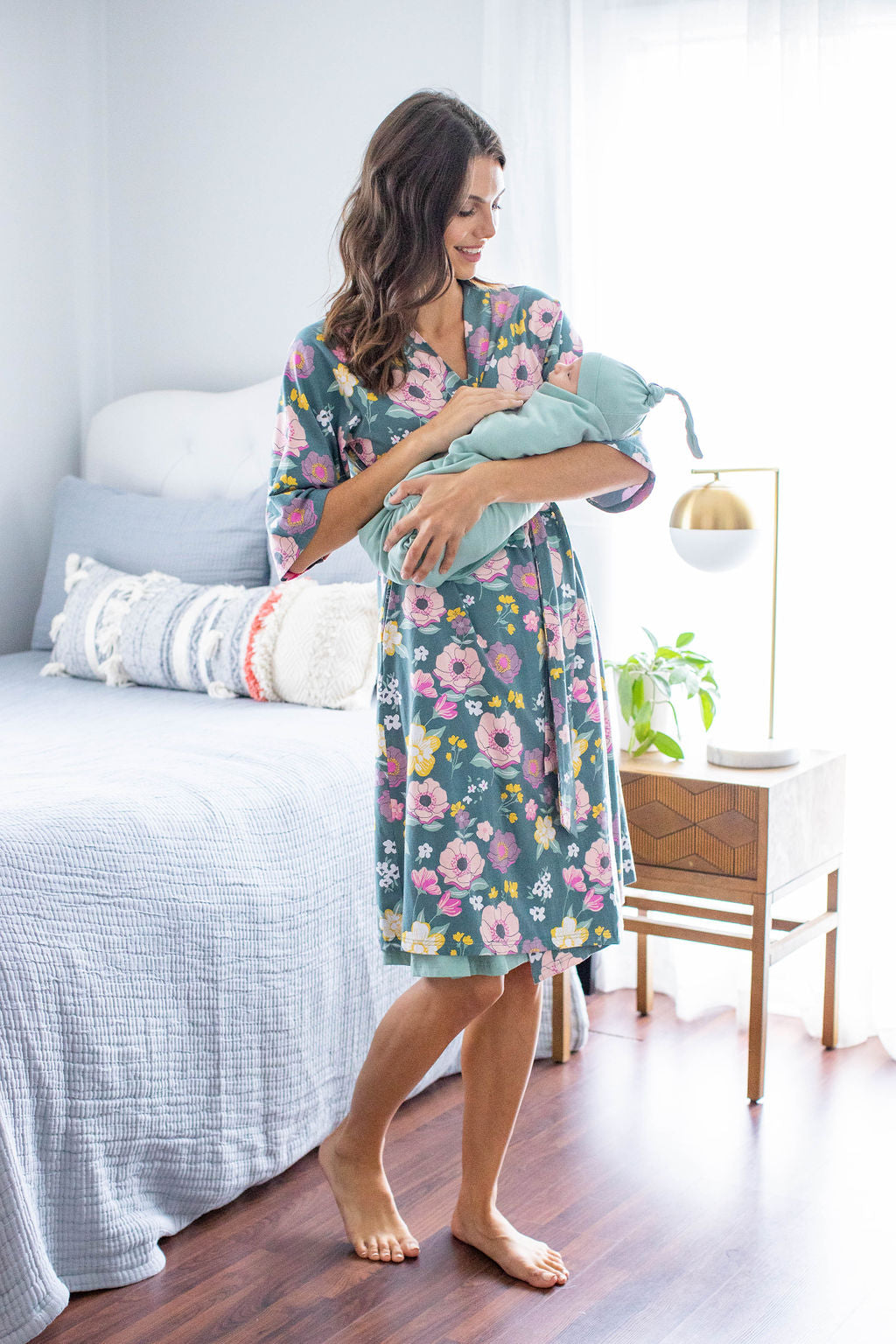 Swaddle your little one in a Sage swaddle blanket to coordinate with your Charlotte robe. Pink flowers against a deep green background. Pink and yellow floral printed robe for ultimate comfort.