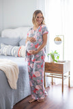 Sophie print with pint and red flowers against a grey background. Pink trim along dolphin hem. Maternity pajamas for mom with easy front snaps for breastfeeding baby. Perfect for pre and post pregnancy.