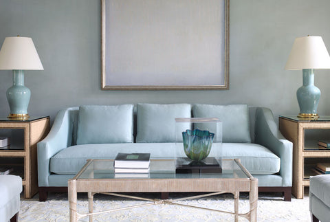 Blue sofa statement piece in family room