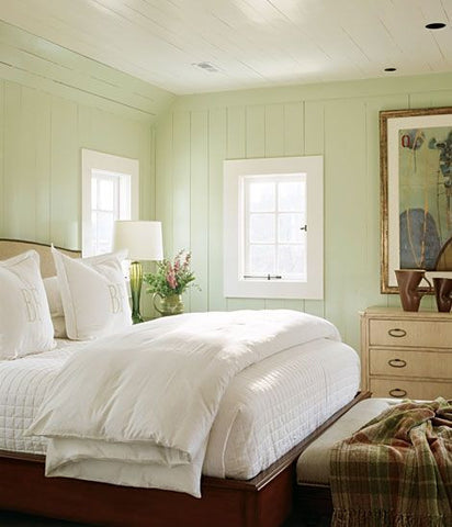 Warm green guest bedroom for two