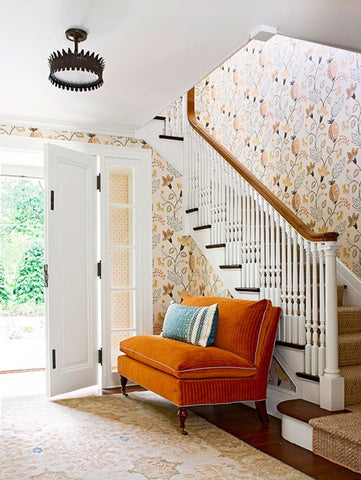 Modern orange and white entryway