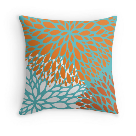 orange and turquoise pillow