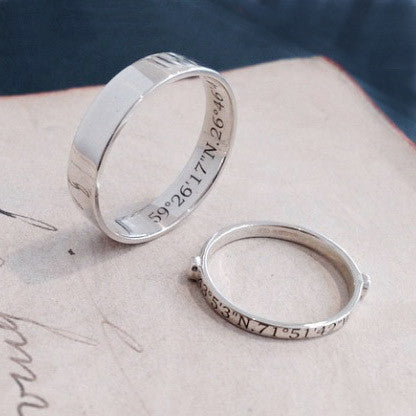 A Set Of Wedding Bands In 9ct White Gold Hers Bespoke Destination Ring Engraved Outside His Custom Fitted Band With The Engraving Hidden Inside
