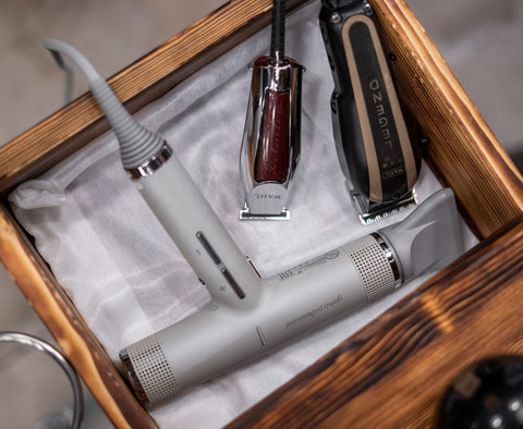 Barber accessories in an open drawer
