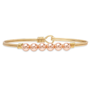Luca + Danni Brass Tone Crystal Pearl Bangle in Peach