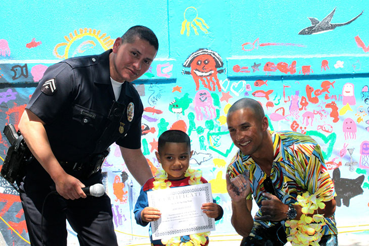 Little boy receiving award from LAPD