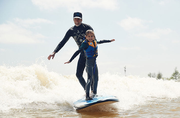 Steve Lippman and girl surfing