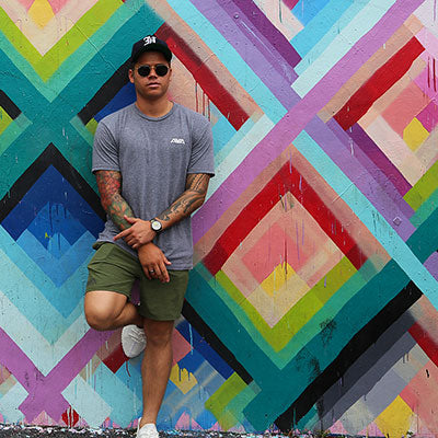 Kekoa standing in front of painted wall