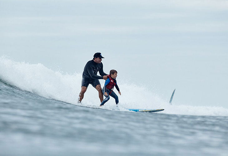 boy and surfer