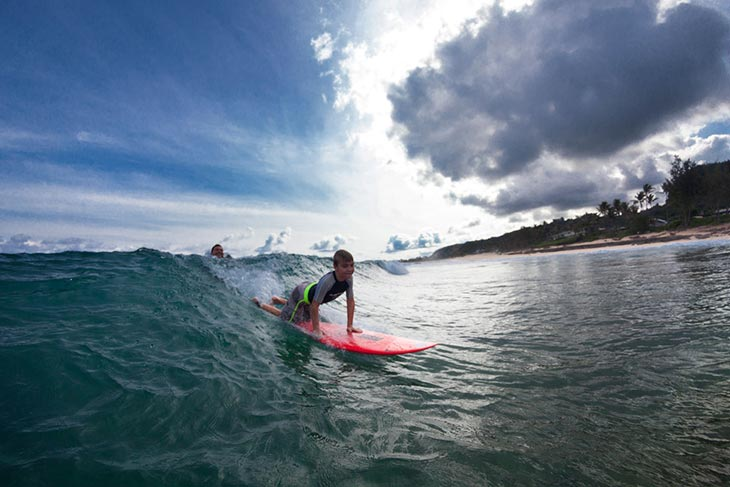Pancho surfing with his son