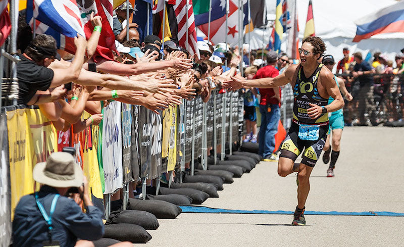 Jesse Thomas, IRONMAN champion winning his 6th Wildflower Triathlon in Bradley, CA