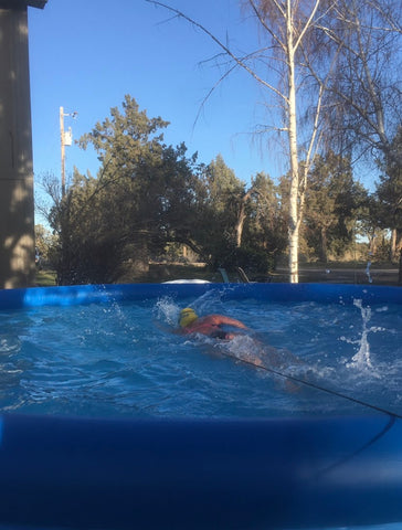 Jessica Kieras in her backyard pool tethered swimming