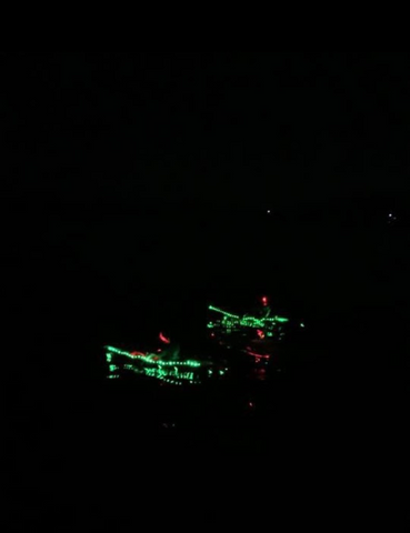 Jessica during the night portion of the Catalina Channel swim with two kayaks on either side of her for guidance.