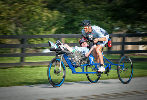 Kyle and Brent Pease of The Kyle Pease Foundation racing on a modified bike