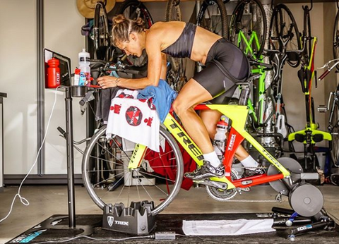 Linsey Corbin pro triathlete during an indoor bike trainer workout