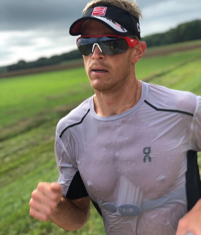 Pro triathlete Matt Hanson running with heart rate monitor