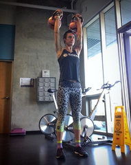 Rachel McBride lifting kettle balls in the gym