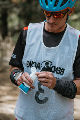 Bones Adventure Racing member apply Zealios Sun Barrier susncreen