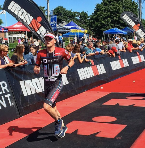 Team member of District Multisport competing in an Ironman 70.3 in Maine