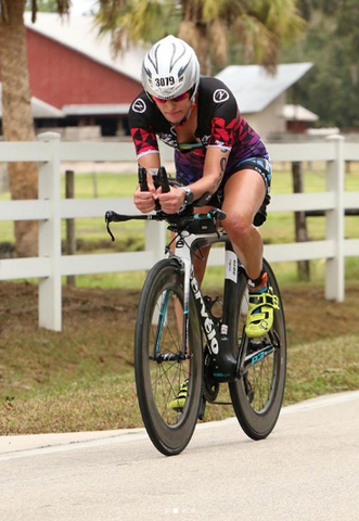 Theresa on the bike course of an Ironman race.