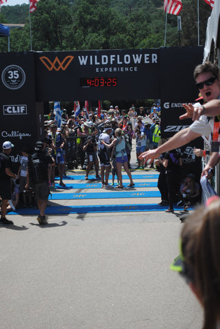 Jesse Thomas Ironman at Wildflower Triathlon finish with wife Lauren Fleshman and family