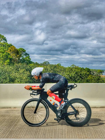 Merge Multisport team member on tri bike