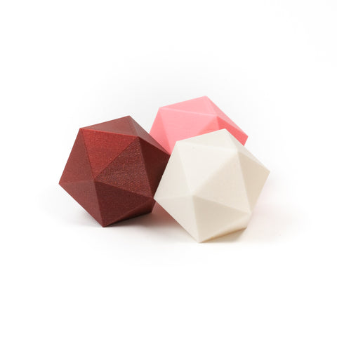 photo of red, pink, white icosahedrons