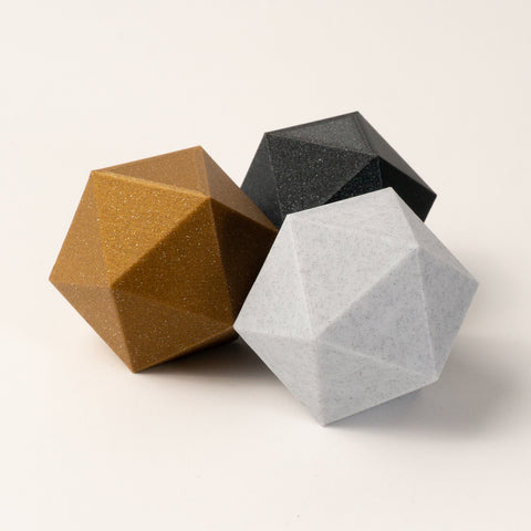 photo of 3 icosahedrons in gold, obsidian, marble