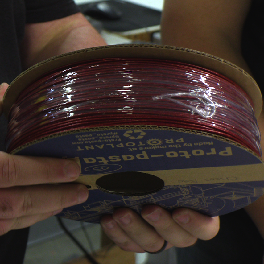 Garrett's Chaos Red filament spool