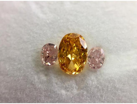 A combination of Natural Orange and Pink Diamonds