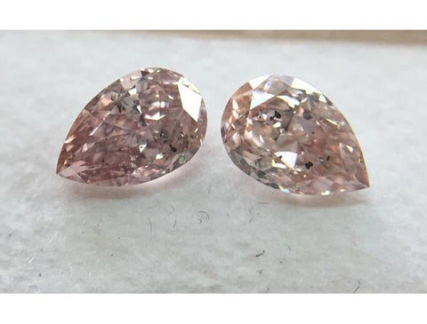 Pear, 1.03 Total Carat Weight, Fancy Orangy Pink, I1, Pair of Diamonds.