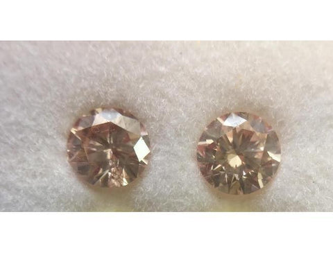 Round, 0.77 Total Carat Weight, Fancy Light Orangy Pink, SI2. natural Loose Pair of Diamonds