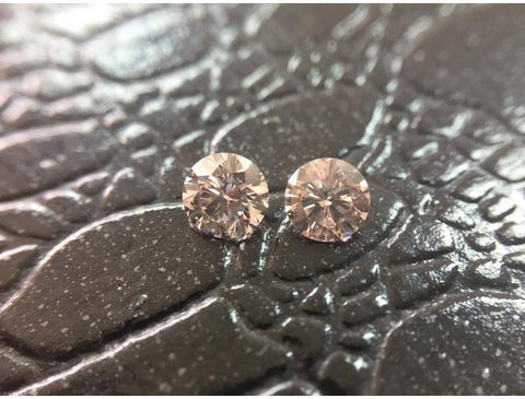 GIA Round 0.77cttw. Fancy Light Orangy Pink SI2. Natural Loose Color Diamonds Pair