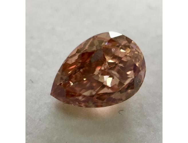 Pear, 1.02 Carat, Fancy Orangy Pink Diamond.
