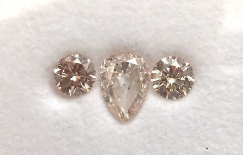 Natural Loose Fancy Light Orangy Pink Diamonds