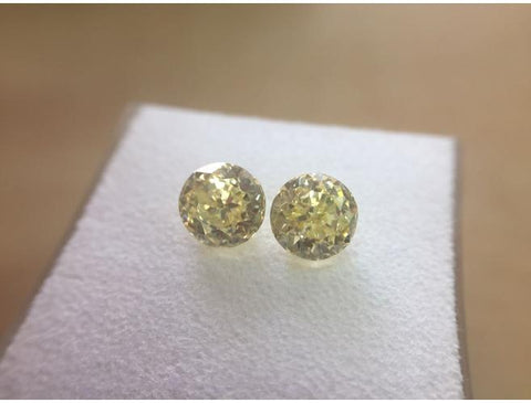 Round Brilliant Cut, 1.84 Total Carat Weight, Fancy Yellow, VVS1. Natural Loose Pair of Diamonds