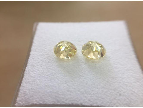 Brilliant, 1.84 Total Carat Weight, Fancy Yellow, VVS1. Loose Diamonds Pair - DahanCollection.Com