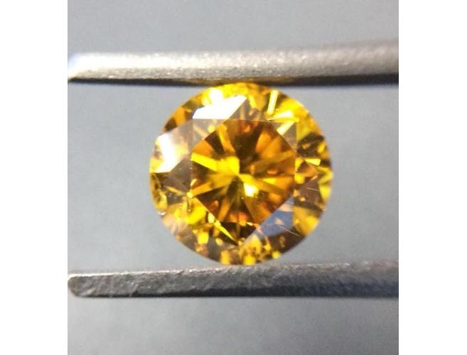 Round, 0.69 Carat, Fancy Vivid Orange Yellow, SI2 Diamond. DahanCollection.com