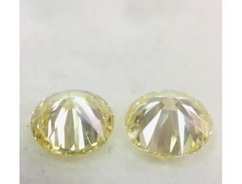 Round, 2.46 Carats, Fancy Light Yellow VVS2/VS2 Pair of Diamonds