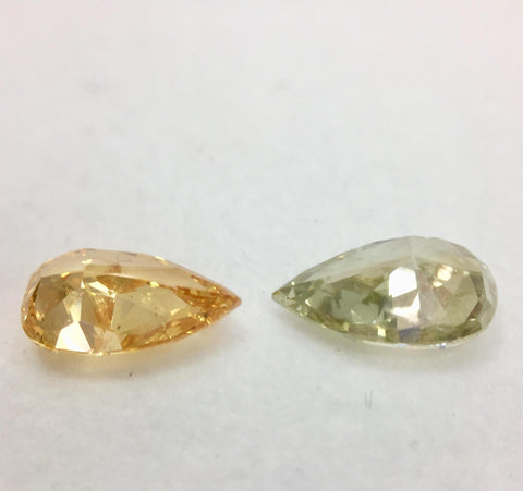 Fancy Vivid Yellow Orange and Fancy Deep Green Yellow Diamonds