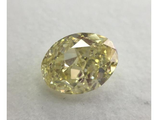 Oval, 1.04 Carat, Fancy Yellow, I1. Loose Diamond.