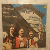 "Greetings From Switzerland  -  Vinyl 7"" Record - Very-Good+ Quality (VG+)"