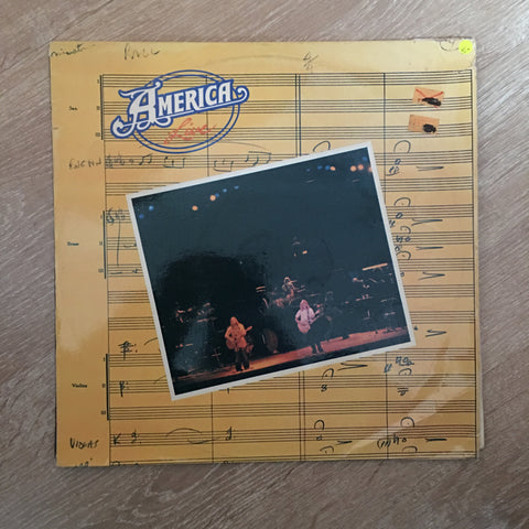 America - Live - Vinyl LP Record  - Opened  - Very-Good+ Quality (VG+) Vinyl