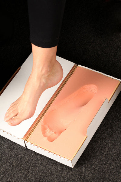 A stomp box is used to make custom molded orthotics