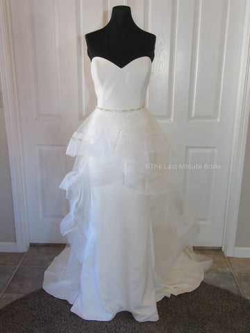 100% Authentic Enzoani Janessa Wedding Dress with a detachable over skirt.