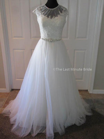 100% Authentic Madison James MJ167 wedding dress from The Last Minute Bride.