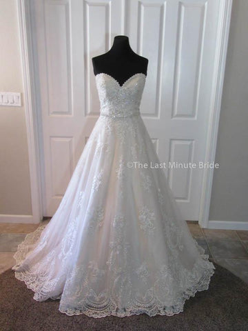 100% Authentic Maggie Sottero Reba wedding dress from The Last Minute Bride.